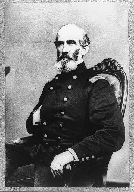 [A.J. Smith, three-quarter length portrait, seated, facing right, right hand in his coat]