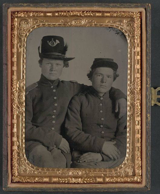 [Brothers Private Hiram J. and Private William H. Gripman of Company I, 3rd Minnesota Infantry Regiment, one with his arm around the other]