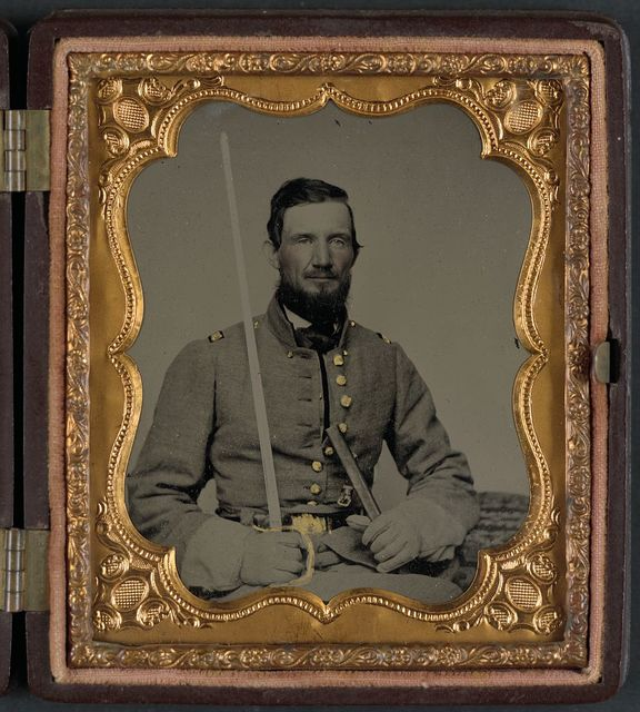 [Captain David Thompson of Caldwell Minute Men (later Caldwell LIght Infantry); Company D, 1st Infantry Regiment 4th Division Missouri State Guard; and Company H, 2nd Missouri Infantry Regiment; holding sword]