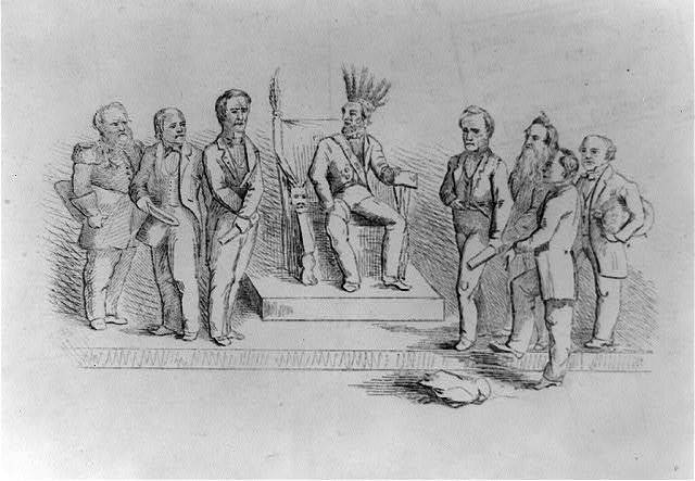 [Caricature of Abraham Lincoln wearing Native American headdress, seated on throne, with seven cabinet officers]