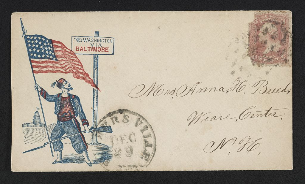 """[Civil War envelope showing Zouave soldier with American flag and rifle in front of sign with message """"Washington via Baltimore""""]"""
