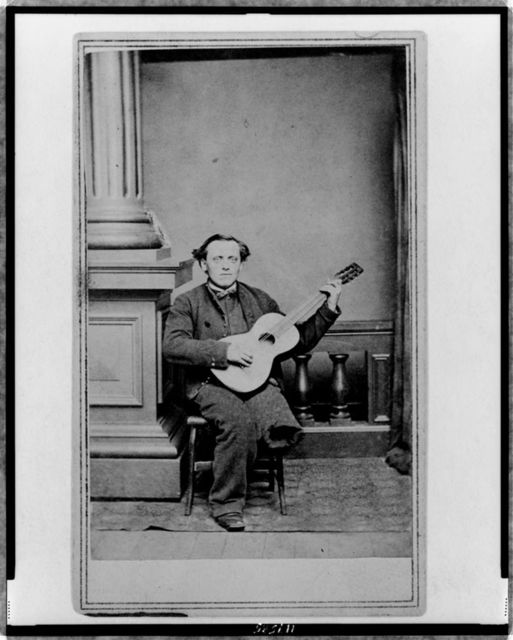 [Civil War soldier, with one leg, full-length portrait, seated, facing front, holding guitar]
