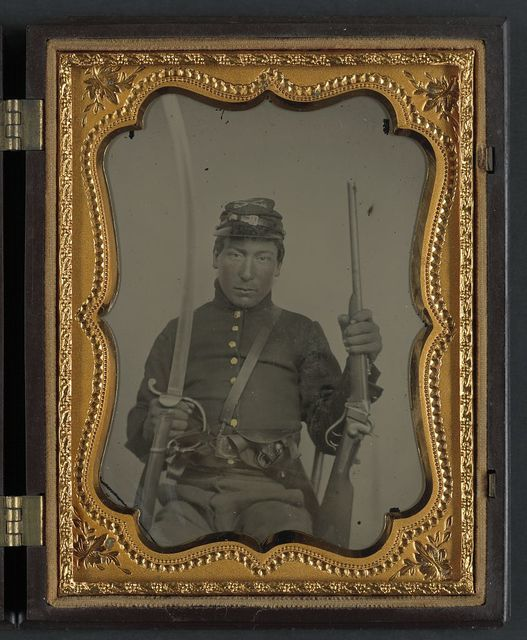 [Corporal Elias Warner or Warnear of Company K, 3rd New York Cavalry Regiment with 1852 Slant Breech Sharps carbine and cavalry saber]