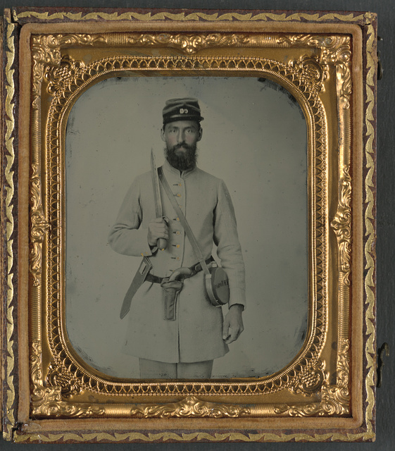[Corporal John Morton Booker of Co. I, 23rd Virginia Infantry Regiment, in uniform with Bowie knife, flintlock pistol, and tin drum canteen with his name on it]