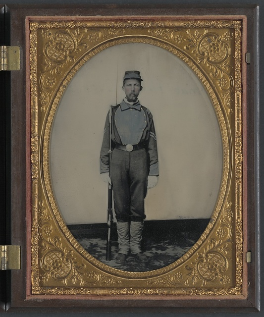 [Corporal Samuel H. Overton of A Company, 44th Virginia Infantry Regiment and A Company, 20th Battalion Virginia Heavy Artillery Regiment in uniform and kepi with bayoneted musket] / Rees.