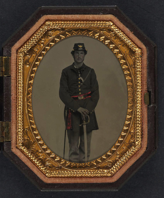 [First Lieutenant Jacob A. Field of Company K, 12th Maine Infantry Regiment in uniform and red officer's sash with sword]
