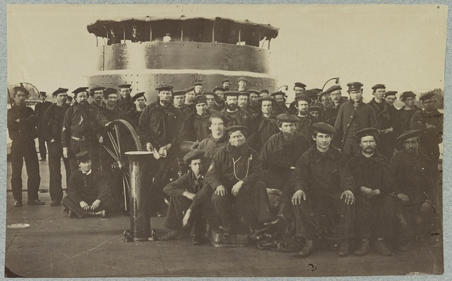 [Group portrait of the crew on the deck of an ironclad]