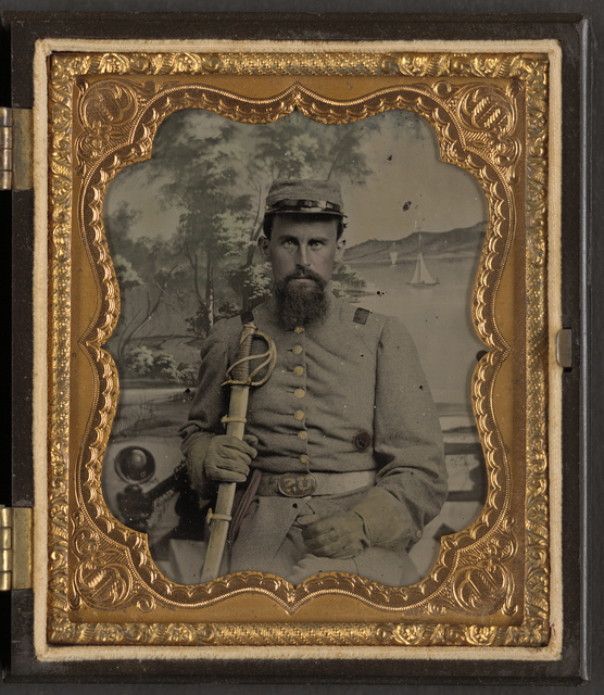 [Lieutenant Robert Pryor James of Co. E, 20th North Carolina Infantry Regiment with sword in front of painted backdrop showing sailboats near forested coastline]