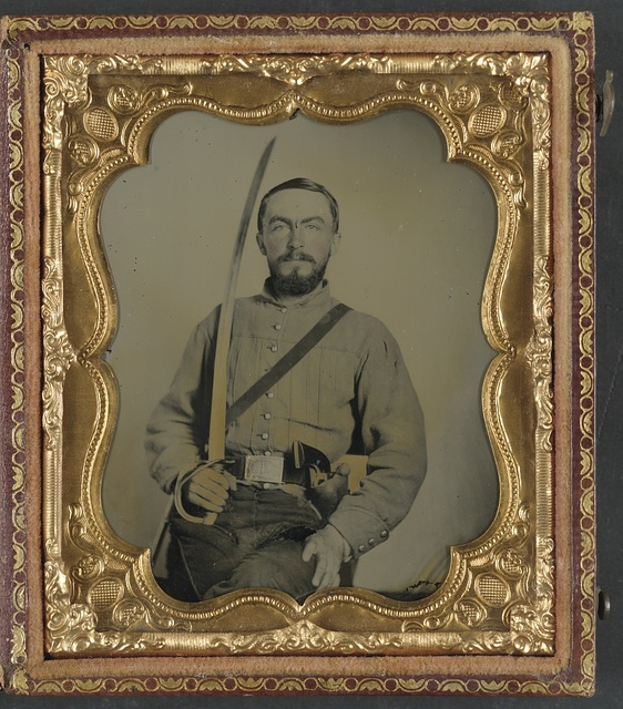 [Lieutenant William Bowen Gallaher of Co. E, 1st Virginia Cavalry Regiment in uniform and Virginia state seal belt plate, with revolver and cavalry sword]