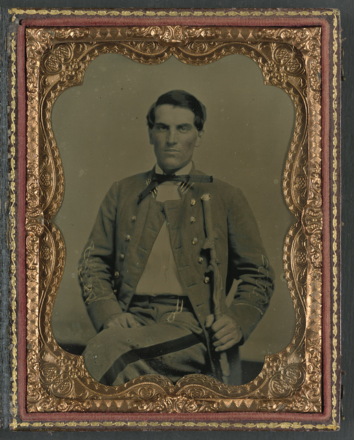 [Major Charles Jones Green of Co. A, 47th Virginia Infantry Regiment, in uniform with carved cane]