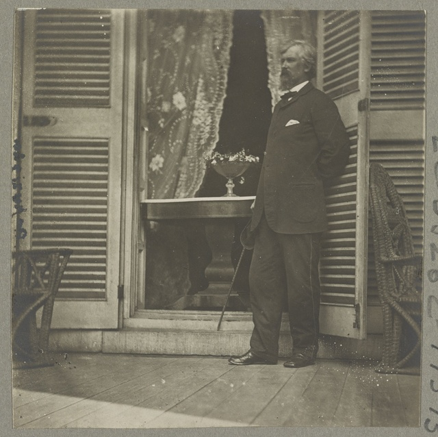 Major Planders at mansion formerly occupied by Jefferson Davis. In the doorway stands the table on which the surrender of Gen. Lee was signed