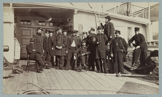 [Navy crewmen on the deck of a ship]