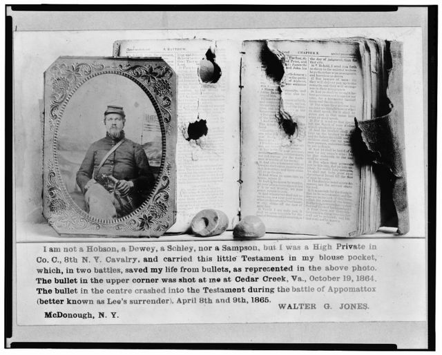 [Photograph of Walter G. Jones, Pvt., 8th New York Cavalry, Co. C., U.S.A., half-length, facing front and his New Testament with bullet holes, and the two bullets which lodged in the book]