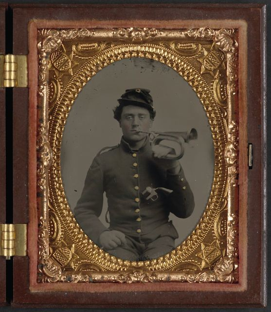 [Private James E. Staley of Band Company, 9th Indiana Infantry Regiment, and Company B, 1st Indiana Heavy Artillery Regiment, holding a bugle to his mouth and carrying a revolver in his jacket]