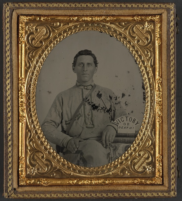 [Private Silas A. Shirley of Co. H, 16th Mississippi Infantry Regiment, with books and sign reading Victory or Death!]
