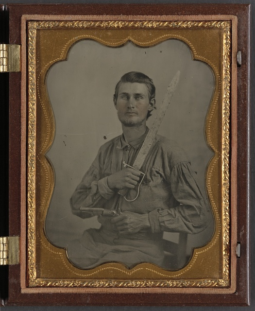 [Private Simeon J. Crews of Co. F, 7th Texas Cavalry Regiment, with cut down saber and revolver]
