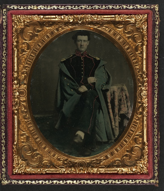 [Private William P. Haberlin of Battery B, Pennsylvania Light Artillery in uniform with shoulder scales and great coat]