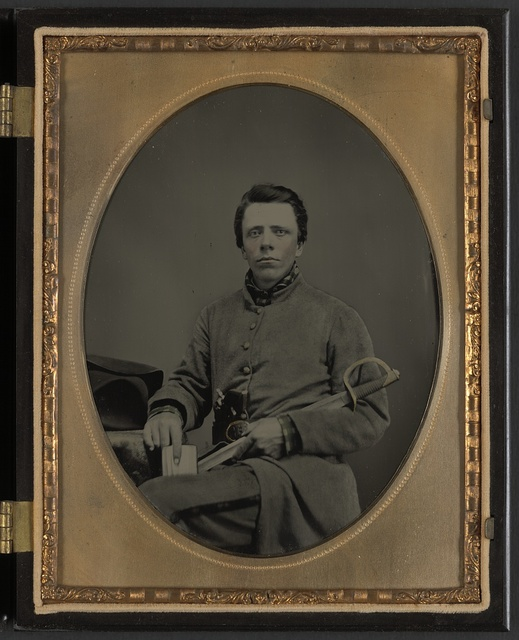 [Private W.R. Clack of Co. B, 43rd Tennessee Infantry Regiment, with saber, pistol, and small book]