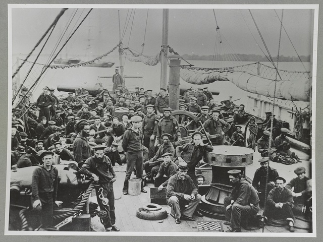 (Sailors on deck of warship)