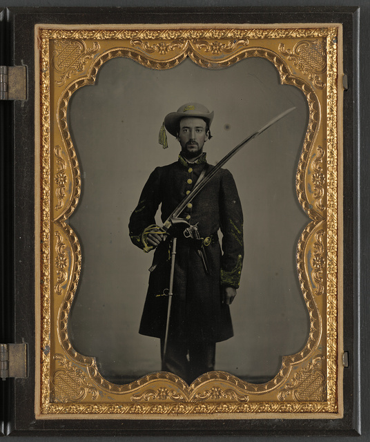 [Sergeant John E. Barlow of 2nd Co. M, 1st Mississippi Cavalry Regiment with sword and revolver]
