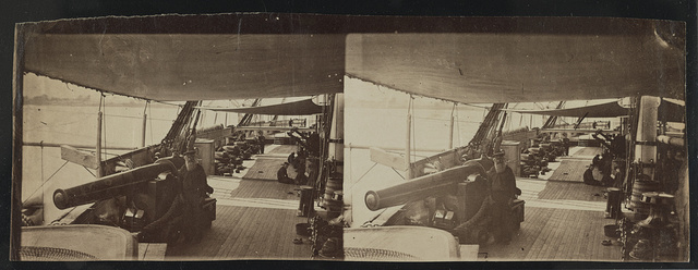 [Ship deck with sailors and cannons]