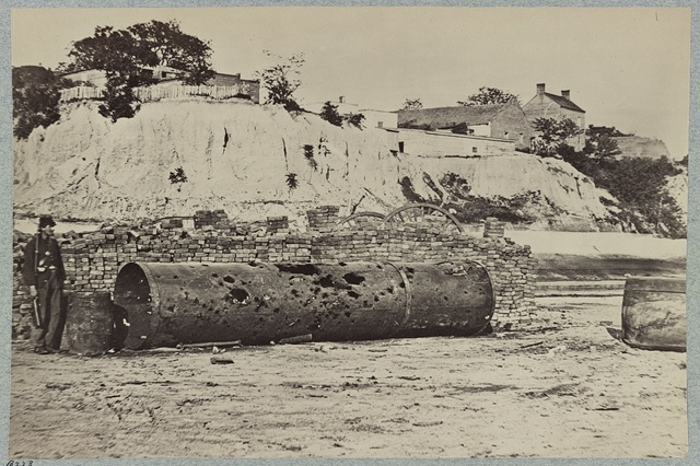 Smoke-stack of Confederate iron-clad Virginia on wharf at Richmond, Va., showing effect of shot in attack on Federal batteries on James River