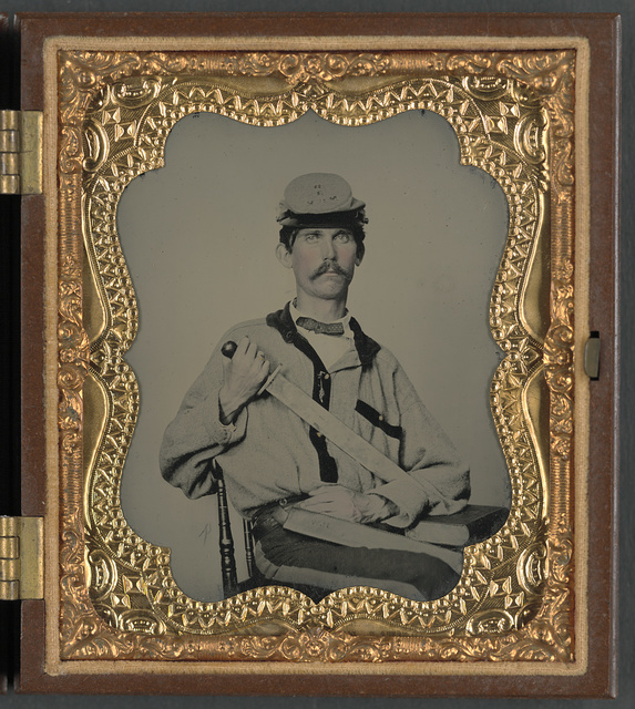 [Soldier in Confederate uniform and Co. D, 3rd North Carolina Volunteers Regiment hat with short sword and sheath with initials J.L.W., probably for Private John L. Wood of Co. D, 3rd North Carolina Infantry Regiment]