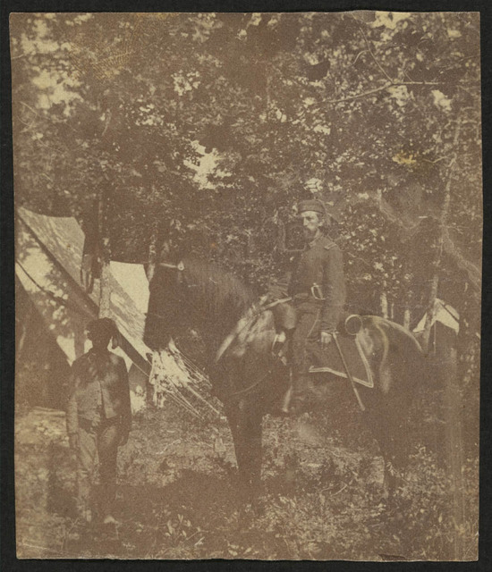 [Soldier on horseback with African American servant]