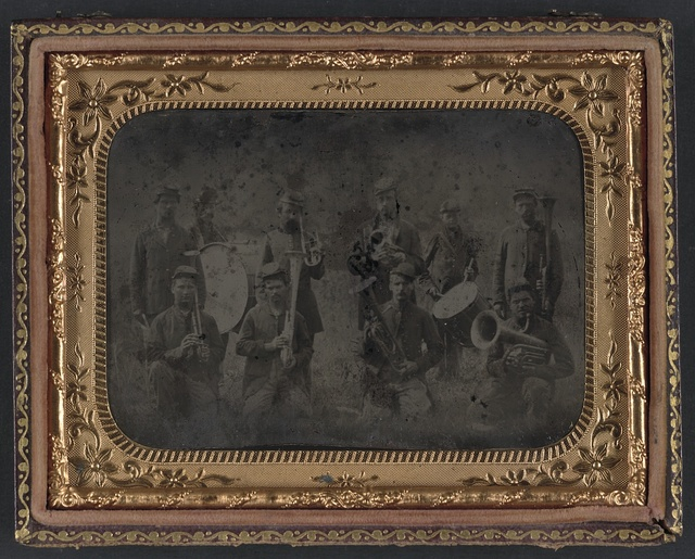 [Ten unidentified soldiers that form a Union regimental band with saxhorns and drums]