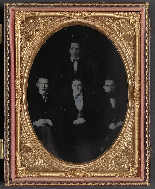 The original four operators of the United States Military Telegraph Corps The figure standing is Samuel M. Brown. Those in the front row, reading from left to right, are David Strouse, David Homer Bates and Richard O'Brien.