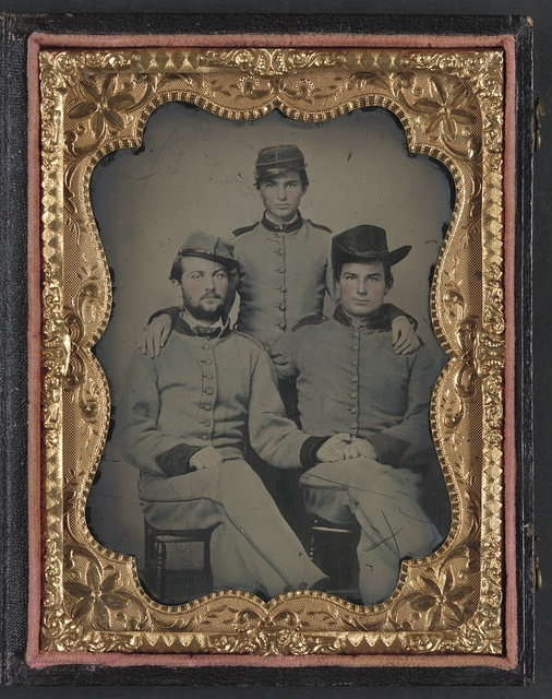 [Three unidentified soldiers in Confederate artillerymen uniforms]