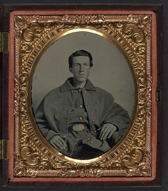 [Two portraits of an unidentified soldier in Union uniform and Zouave uniform with bayonet and sheath, bowie knife, and Smith and Wesson revolver]