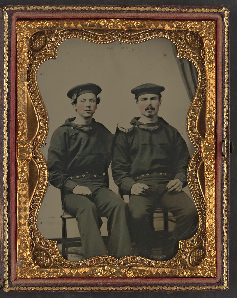 [Two unidentified sailors in Union uniforms seated outdoors]