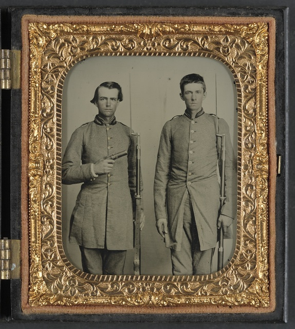 [Two unidentified soldiers from Tennessee in Confederate uniforms with rifles and pepperbox pistol]