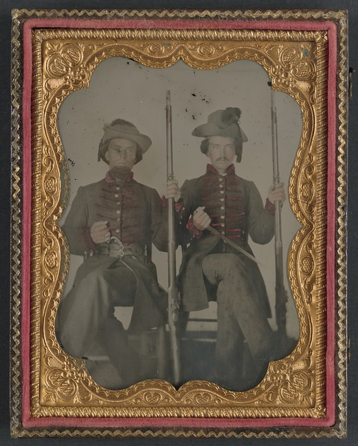 [Two unidentified soldiers in Confederate uniforms with muskets and bayonets]