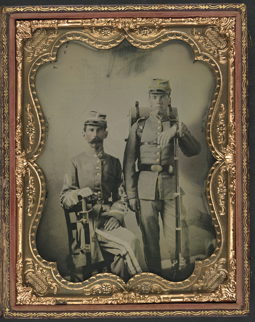 [Two unidentified soldiers in Confederate uniforms with sword, bayoneted musket, and knapsack]