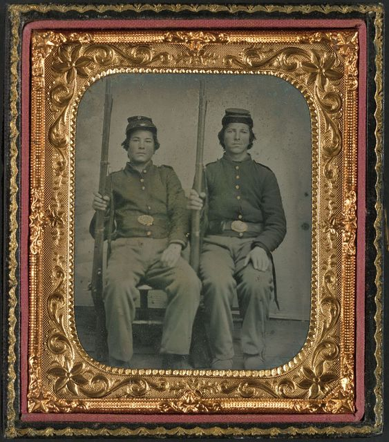 [Two unidentified soldiers in Union uniforms holding muskets]