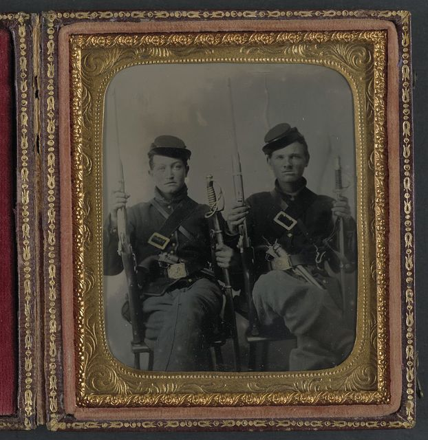 [Two unidentified soldiers with Spencer carbines, 1860 sabers, and Colt Army revolvers, probably Union uniforms]