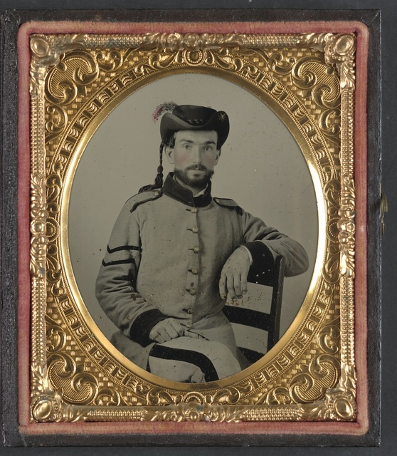 [Unidentified corporal in Confederate uniform and hat with tassel]