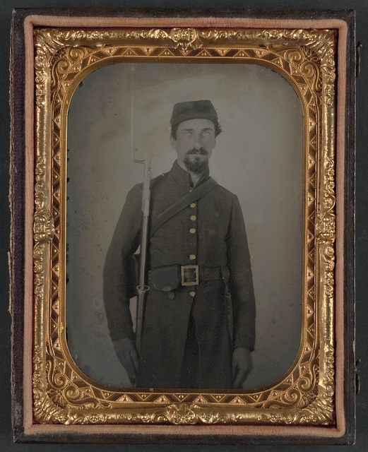 [Unidentified private in Confederate uniform and Georgia frame buckle with bayoneted musket]