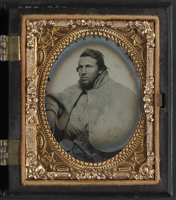 [Unidentified soldier in 1st Virginia cavalry great coat]