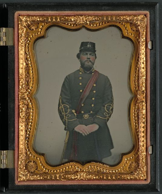 [Unidentified soldier in Confederate captain's uniform, red sash, and kepi marked V.V.]