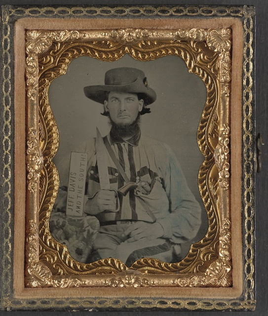 [Unidentified soldier in Confederate cavalry uniform with D-guard Bowie knife, revolver, canteen, and sign reading Jeff Davis and the South!]
