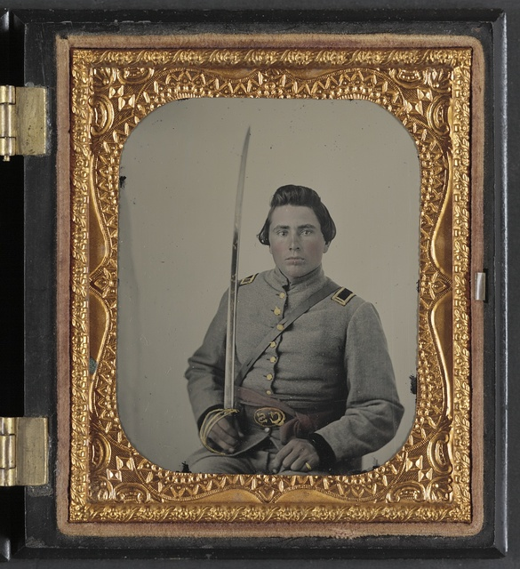 [Unidentified soldier in Confederate lieutenant uniform and CS belt buckle with cavalry sword]