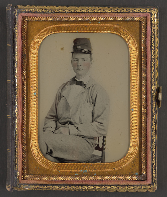 [Unidentified soldier in Confederate uniform and hat with initials C.R.]
