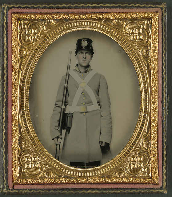 [Unidentified soldier in Confederate uniform and kepi with musket]