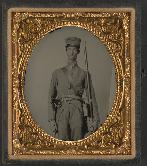 [Unidentified soldier in Confederate uniform with bayoneted musket and pistol]