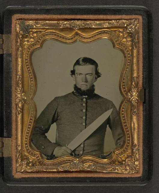 [Unidentified soldier in Confederate uniform with Bowie knife]