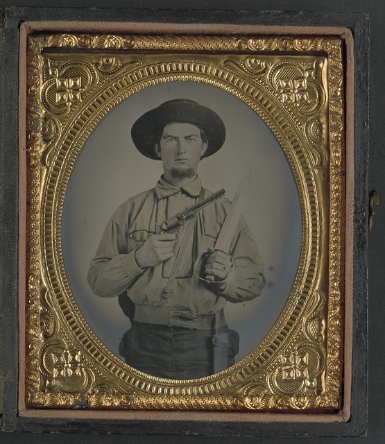 [Unidentified soldier in Confederate uniform with Colt Navy revolver and double handle D-guard Bowie knife]
