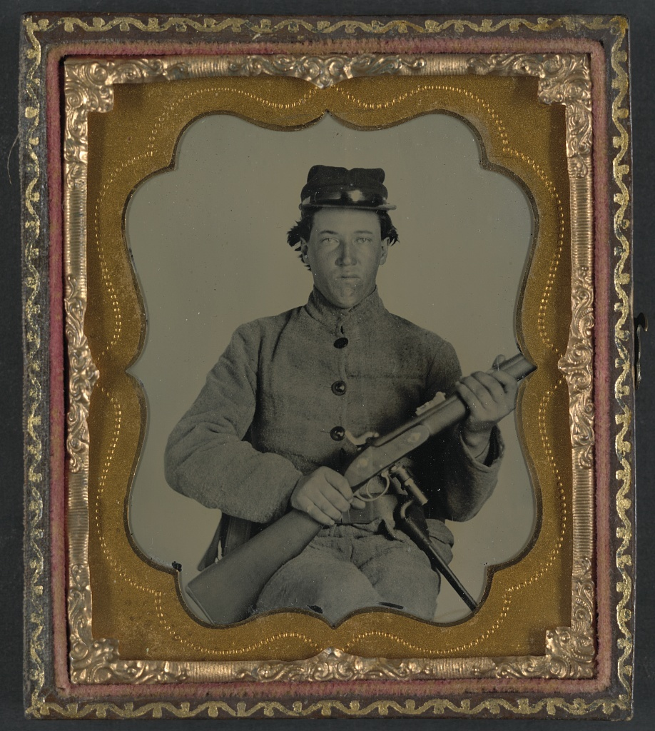 [Unidentified soldier in Confederate uniform with Enfield rifle]